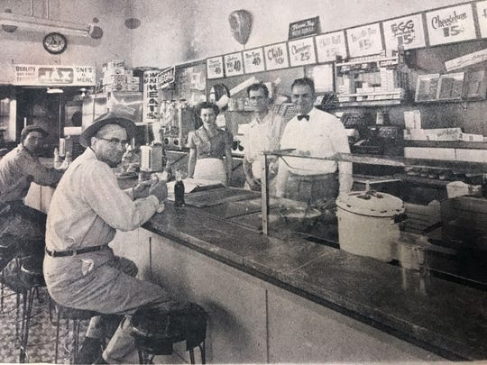 Customers at the California Sandwich Shop during the time of the Korean war. Customers and employees pictured are, from left, a Mr. Stewart, J.C. West, Clifton White, Marie Taylor, Ernie Katsaboulas and owner Paul Vasselus.