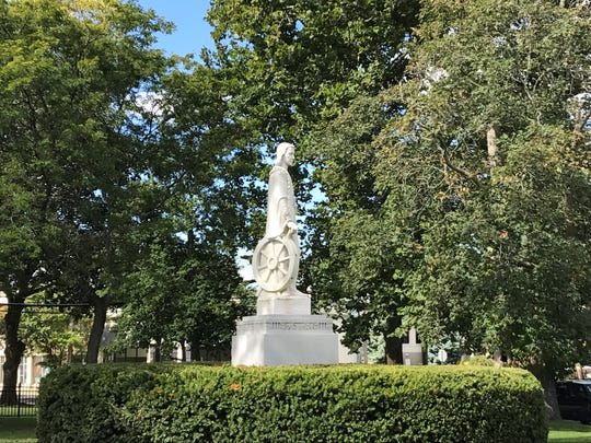 A statue of Christopher Columbus stands at Slocum Park