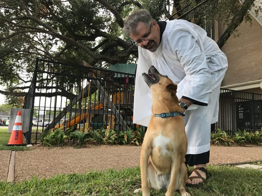 The Rev. Jonathan Wickham and Ginger, his loyal companion, invite the community to the first ever drive thru blessing of the pets Wednesday, Oct.4 at All Saints' Episcopal Church in Corpus Christi.