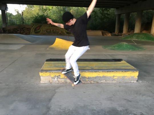 Grant Koniski, 22, of Clifton, grinds on the grindbox,