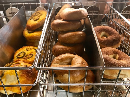 Racks of house-baked bagels line the counter at the