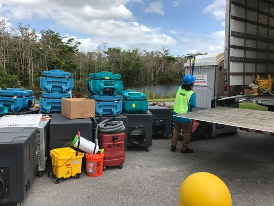 Workers at Vi at Bentley Village remove equipment used