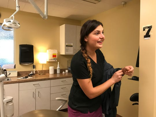 Kenna Tyree, 24, finishes up her work as a dental hygienist at Hill Country's Round Mountain clinic.