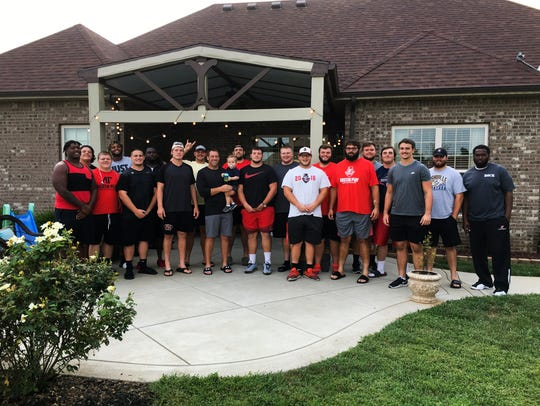 Joshua Eargle with Austin Peay's offensive line players