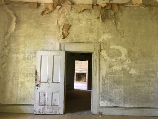 Peering through two doorways in the historic Holt mansion in Brentwood shows an original fireplace in a room across the hall. David and Jodie Smith, the second family to own the mansion since it was built in the 1830s, are working to restore it.