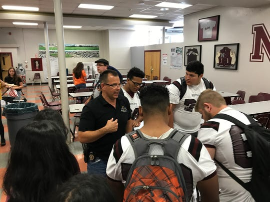 Nutley Police Det. Michael Padilla coordinates a Nutley High School team to distribute information on Oct. 6, 2017, during Knock Out Opioid Abuse Day.