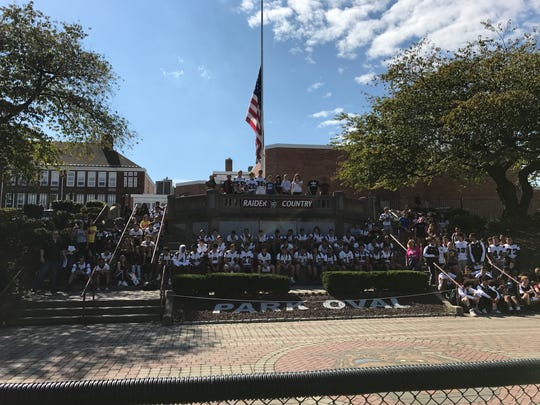 Nutley High School athletes gather to distribute information on Oct. 7, 2017, during Knock Out Opioid Abuse Day.