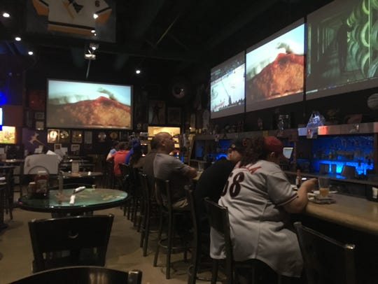 Arizona Diamondbacks fans watch the opener of the NLDS