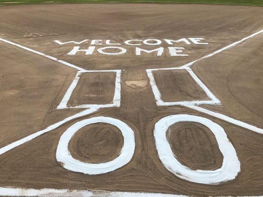 A sign in chalk welcomed home 12-year-old Auston Strole at a Thursday ceremony at the Red Bluff Little League field.