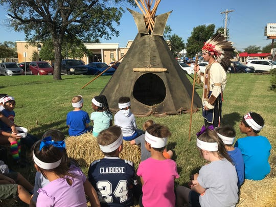 """First- and second-grade students from Jackson Elementary take in the history of the Kosari native American tribe, presented by the Ogallala Club of McMurry University during the school's homecoming """"Tipi Village"""" Friday, Oct. 6, 2017."""