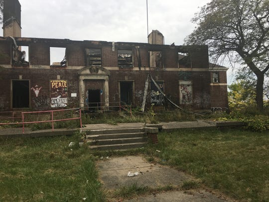 The Kronk Gym, is in charred ruins following the previous night's fire in Detroit on Sunday, October 8, 2017.