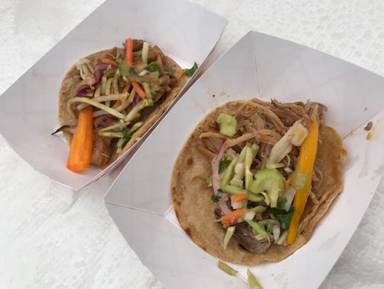 The Filipino Adobo Chicken Taco (left) and the Sisig