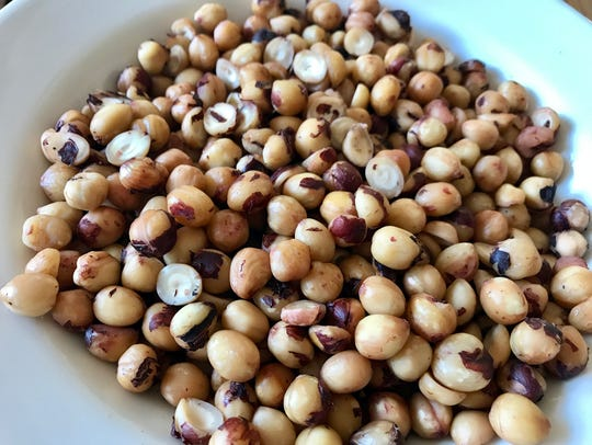 Roasting and rubbing hazelnuts in a towel removes much