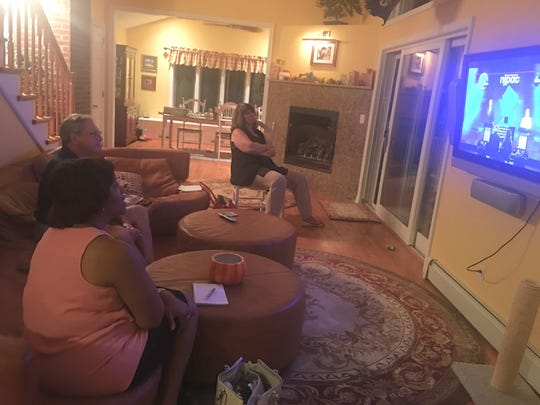 Voting Block participants Lisa McKoy, front, and Louis and Jeanine Lamatina watched the gubernatorial candidate debate Tuesday night.