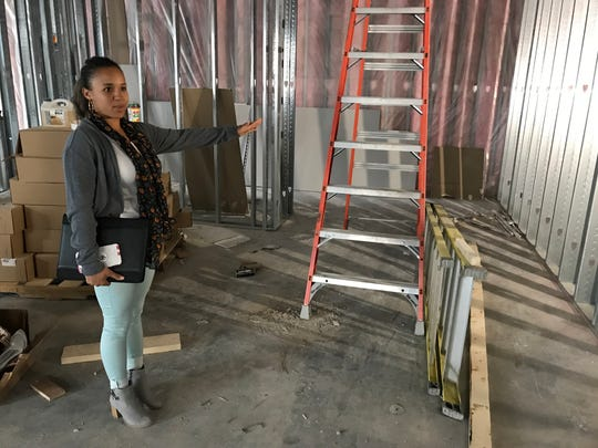 Inkka Beaudion, owner of Swamp Daddy's Cajun Kitchen, gives a tour of the construction at her new restaurant space in this 2018 file photo.
