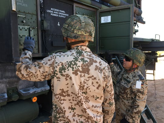 German soldiers work to get a Patriot launcher set