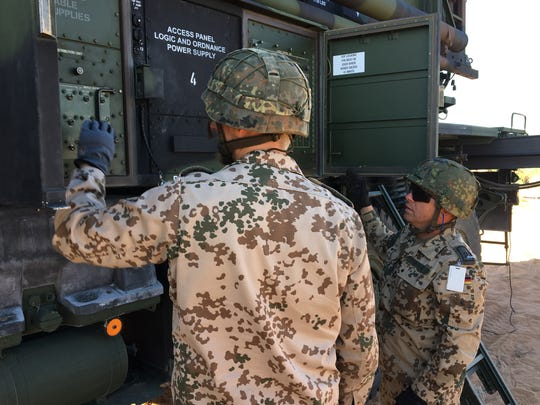 German soldiers work to get a Patriot launcher set up during a training exercise at Fort Bliss.