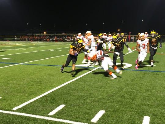 Cedar Grove running back Ryan Turi avoids a tackle