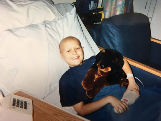 636433428556334270-Colby-with-stuffed-dog-at-9.JPG