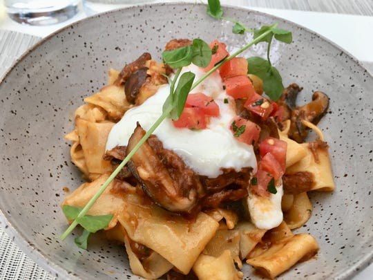 The lamb ragout ($24) features flat pappardelle noodles, braised lamb, wild mushrooms and a hearty tomato sauce. A dollop of whipped goat cheese topped it off.