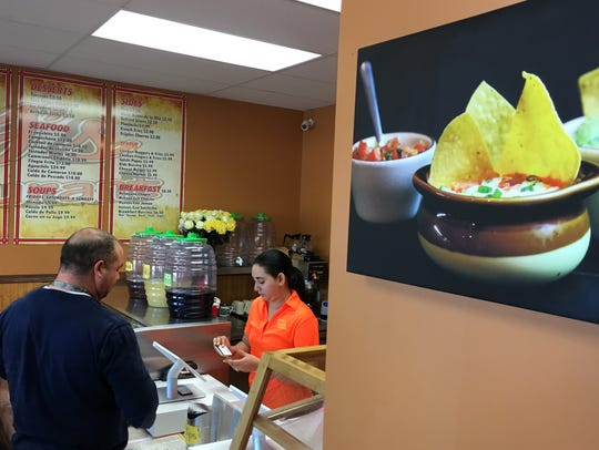 A customer orders inside Jacky's Burrito Express, located at 2315 W. 12th St. in Sioux Falls.