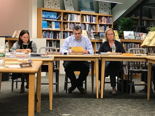 School Board President Gregg Lambert reads a statement at the Oct. 12 Closter Board of Education meeting, stating school board members cannot comment on personnel issues.
