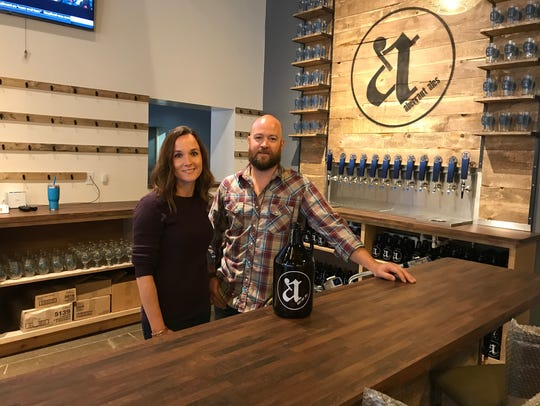 Aberrant Ales owners Lisa and Clark Gill show off the
