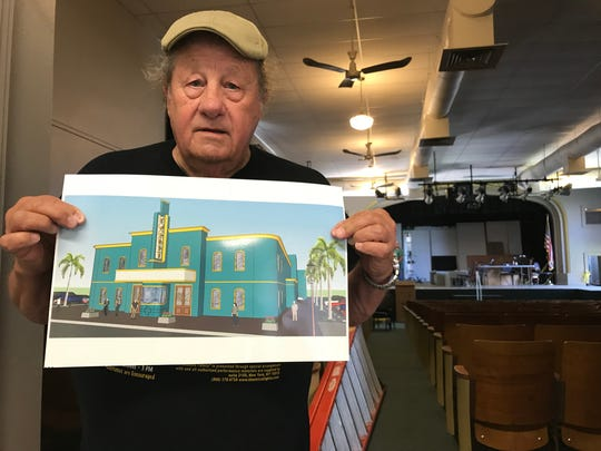 Jim Smith, board member and set designer for Rockport Little Theater, holds up an illustration of the new building the non-profit is raising funds to make a reality while the Rockport Elementary School theatre, is in the background.