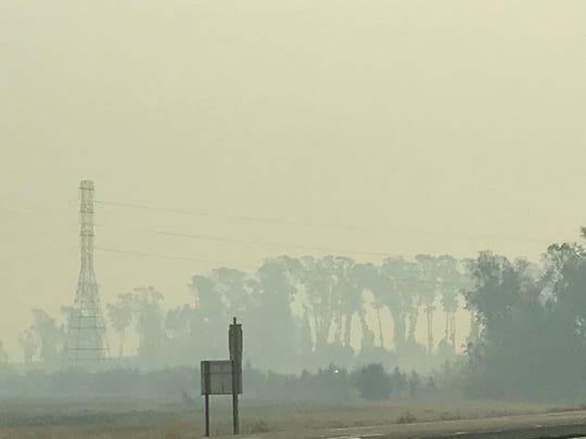 Smoke in the air in the Napa Valley on Wednesday, Oct. 11 obscuring trees and turning the skies a leaden grey.