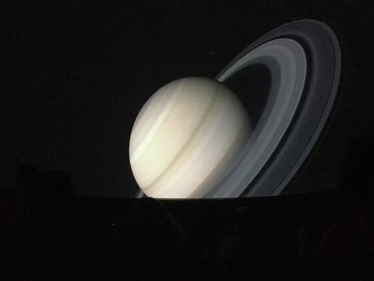 Jupiter is projected on the dome of McCullough Middle School's newly remodeled planetarium.