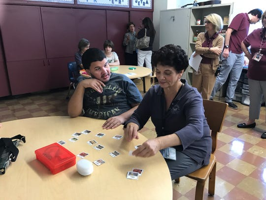 Paraprofessional Lucy Bencivenga helps Christian with