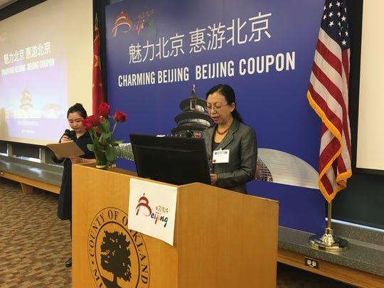 Wang Yue, Vice Chair of the Beijing Tourism Development Commission, encourages Michiganders to visit Beijing while speaking through an interpreter Friday, Oct. 13, 2017 at the Oakland County Executive Office Conference Center in Waterford.