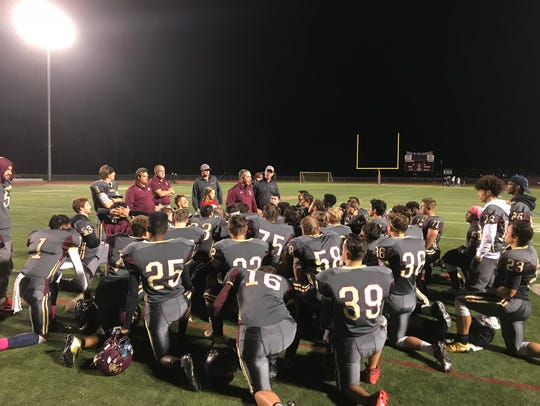 Arlington High School football coach Mike Morano meets