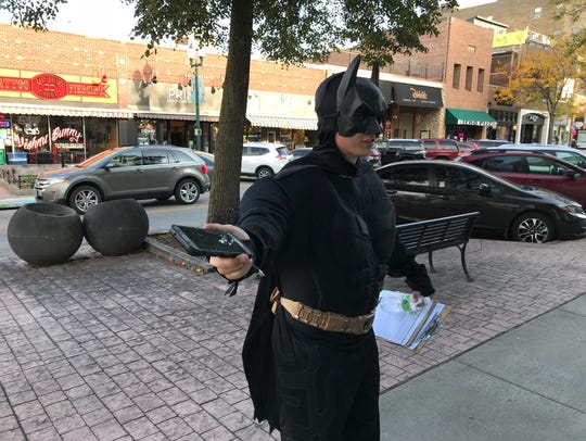 A man dressed as Batman was collecting petition signatures