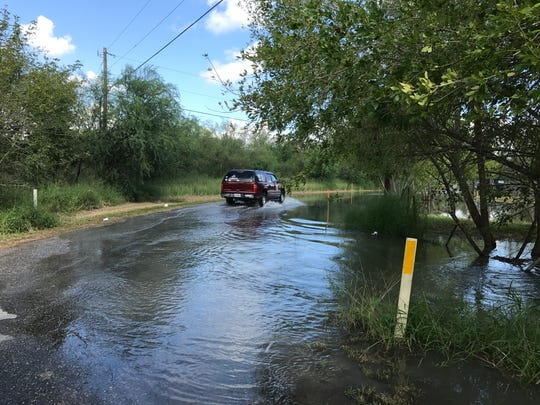 Parts of County Road 73 were flooded but passable Friday and expected to remain submerged as water is released from Lake Corpus Christi.