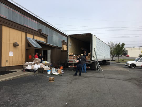 Restaurant workers load supplies after the Murfreesboro