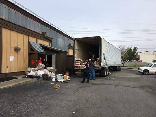 Restaurant workers load supplies after the Murfreesboro location of Logan's Roadhouse closed permanently this week.