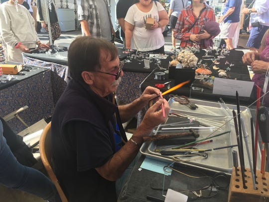 "Ken Curtiss, of ""Original Designs & Glass,"" blows glass Saturday at the 46th Annual Virginia Fall Foliage Festival."