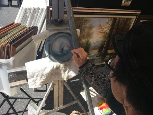 Artist Thomas Om paints with oil colors Saturday at the 46th Annual Virginia Fall Foliage Art Festival.