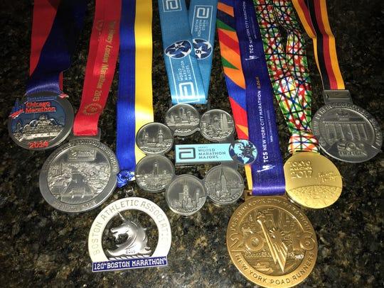 Marathon medals, including the prestigious Six Star