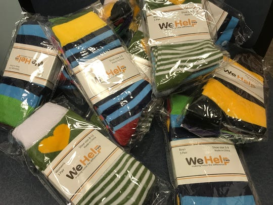 urnam is selling packs of three pairs of socks for