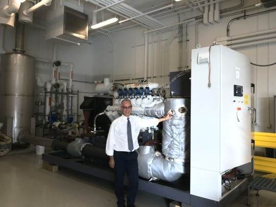 Engineer Talal Hindi with a combined heat and power