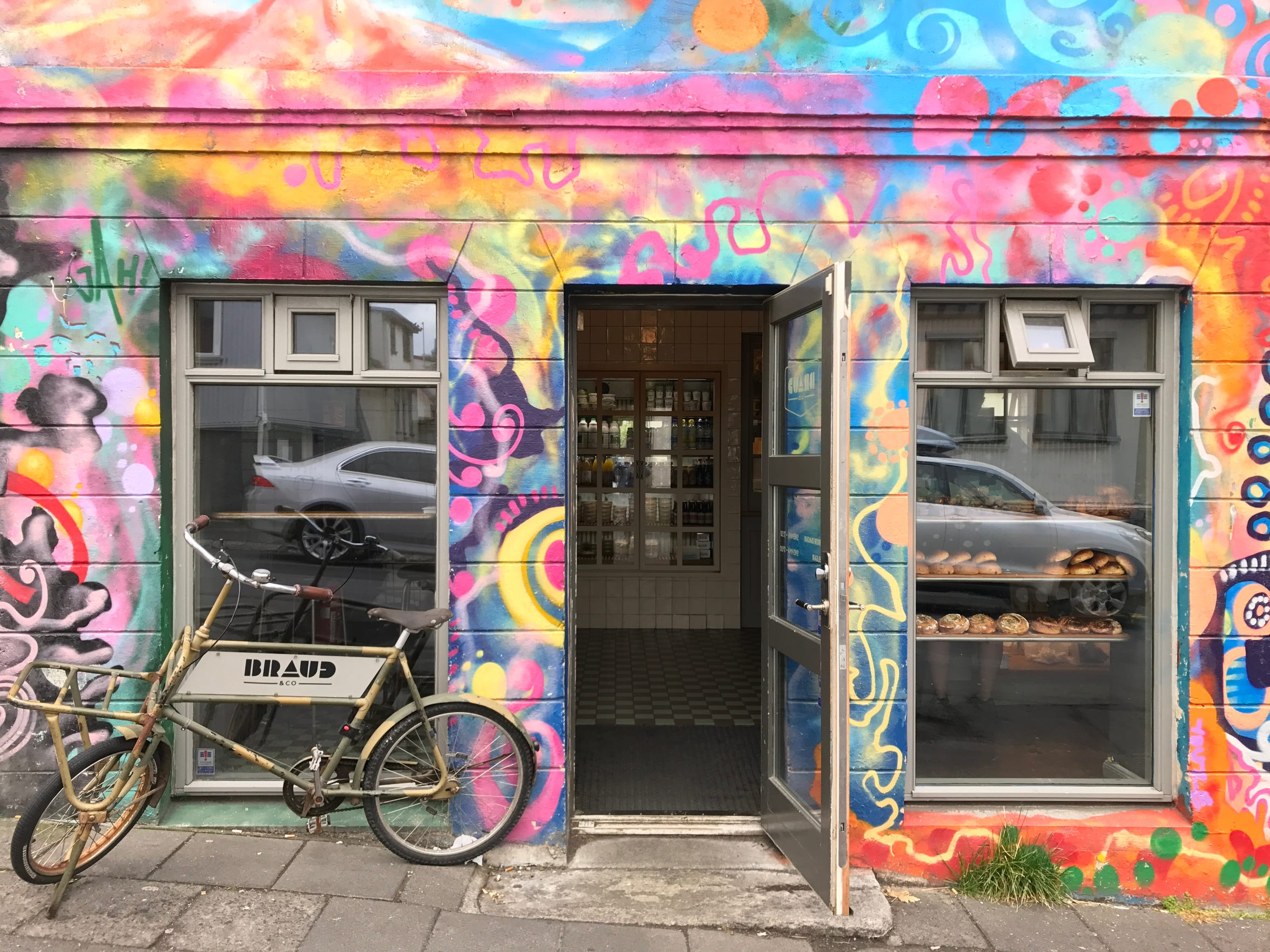 A colorful bakery in Reykjavik makes the pastries even more inviting. makes the pastries even more inviting.