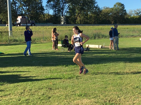 Josie Powe, an eighth grade runner from Eastwood, finishes