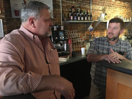 Randy Eckman, left, owner of Fox's Pizza Den in Prattville, talks with Pat Harrington, the restuarents director of operations.