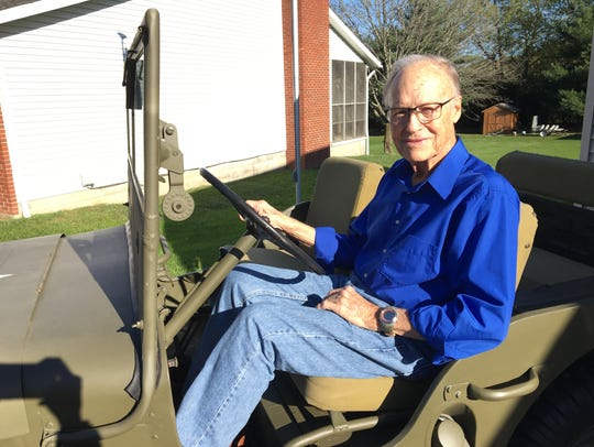 Korean War veteran Cloyd McNaull sits in a World War