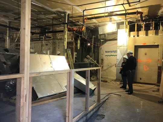 Two workers survey the gutted interior of the old Chancery