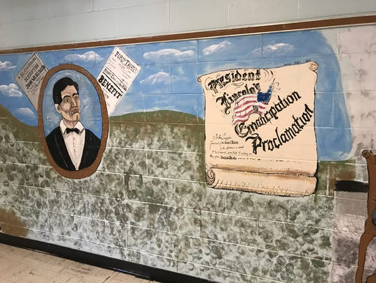 A section of a mural in Wappingers' Fishkill Plains Elementary School that depicts images related to the Civil War.