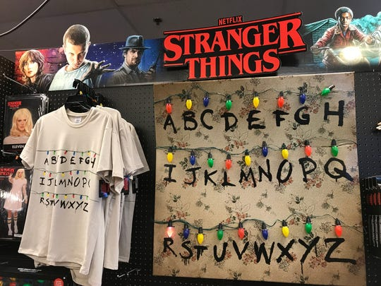 "A Spirit Halloween ""Stranger Things"" costume display"