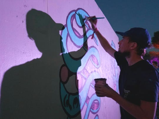 Clay Holling is a Phoenix artist who painted a mural on day one of the Lost Lake Festival.